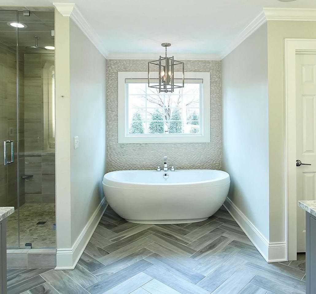 Master-Bath-Herringbone-floor-tile-pebble-backsplash-Large-tub ...