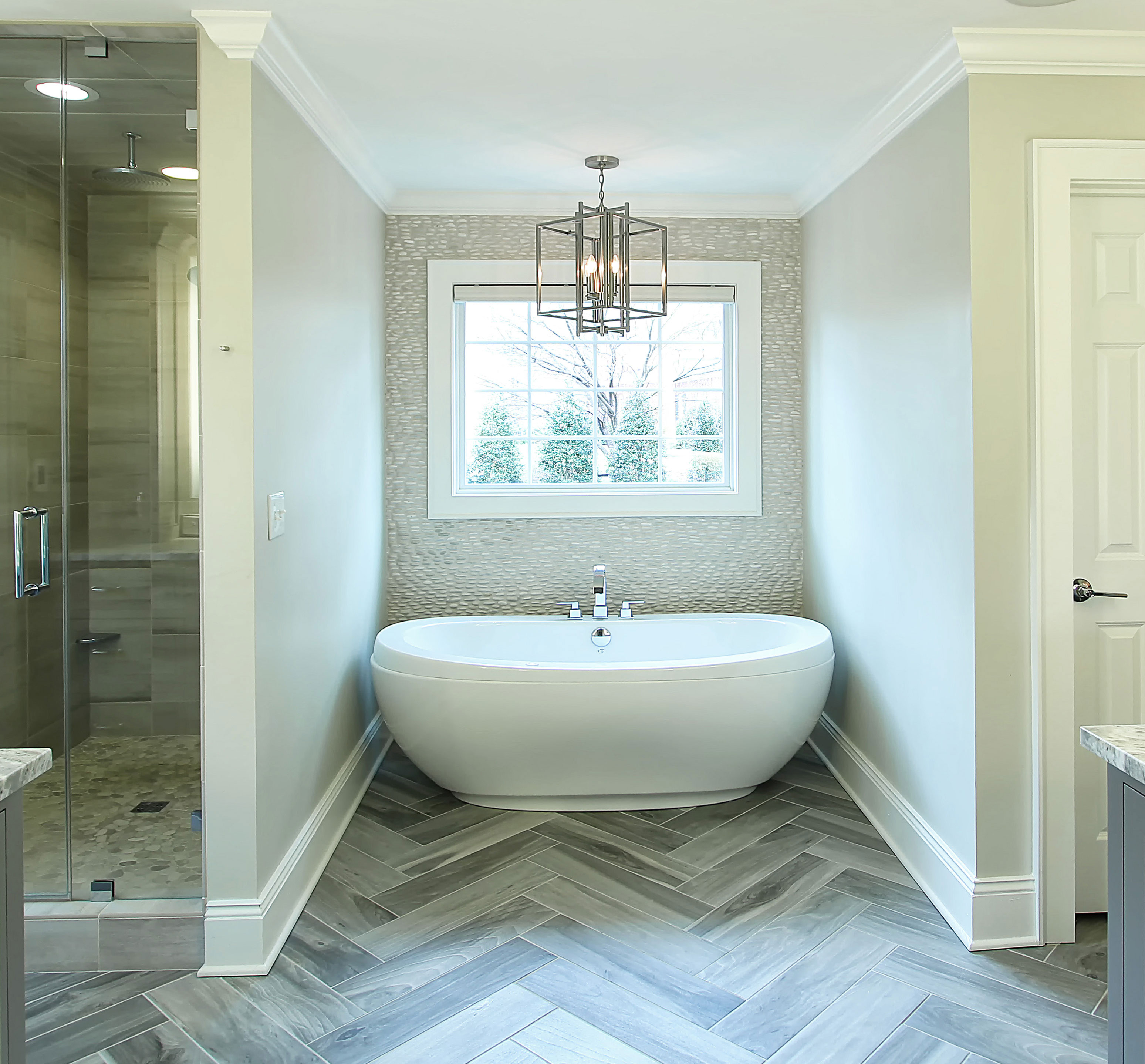 Master-Bath-Herringbone-floor-tile-pebble-backsplash-Large-tub ...